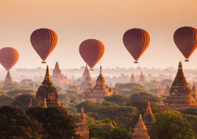 Hot air balloons over the plains of Bagan, Myanmar which is 1 of the Top 20 Budget Travel Destinations in 2020 #travelclans #Myanmar #Bagan #BudgetTravel #Travel #Destinations